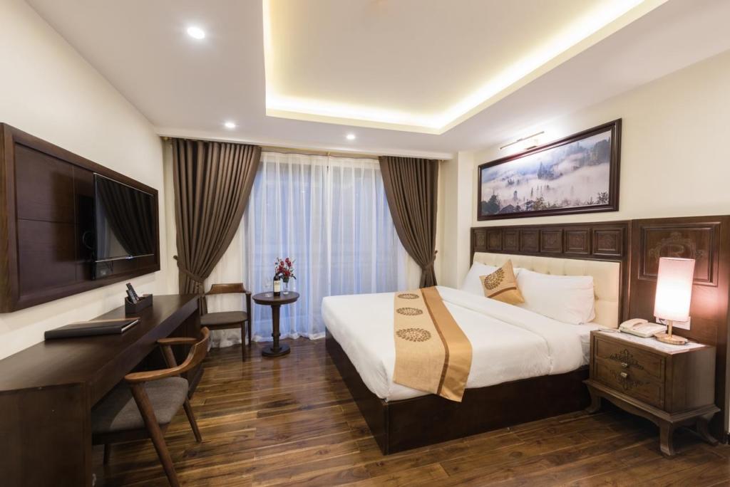phong ngu noi that khach san relax hotel sapa 1024x684 - Thiết kế & thi công nội thất khách sạn 4 sao Sapa Relax Hotel & Spa